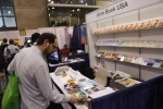 An attendee is browsing a book at Book Expo America on May 24, 2011.