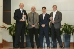 Micron and Intel executives accept the 2011 Semiconductor of the Year award for 20nm NAND. Pictured left to right: Glen Hawk, Micron; Harry Page, UBM; Joel Martin, UBM; Rob Crooke, Intel. (사진제공: Micron Technology)