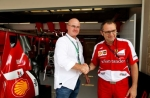At the Circuit of The Americas track in Austin, Texas (the location of the 2013 Formula 1 U.S. Grand Prix), Oakley CEO Colin Baden and Scuderia Ferrari Team Principal Stefano Domenicali celebrate the signing of a new partnership agreement between the