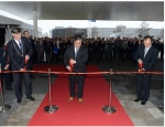 Emmen Mayor Cees Bijl, Menicon CEO Hidenari Tanaka and Japanese diplomat Yutaka Kikuta cut the ceremonial ribbon to open Menicon's new facility at Emmen, the Netherlands.