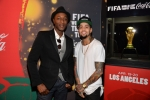 Aloe Blacc and David Correy at the FIFA World Cup(TM) Trophy Tour by Coca-Cola experience in Los Angeles before performing 'The World is Ours' by Aloe Blacc x David Correy.