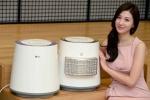 서울 여의도 LG트윈빌딩에서 모델이 위생기능을 강화한 'LG 에어워셔' 신제품을 소개하고 있다.