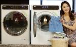 LG전자가 최대 20가지의 다양한 세탁 코스를 사용할 수 있는 꼬망스 세탁기 신제품을 29일 출시했다. LG전자 모델이 27일 여의도 LG 트윈타워에서 꼬망스 신제품을 소개하고 있다.