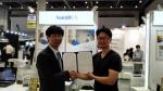 사운드유엑스와 일본 SSJ 주식회사가 일본 영업 파트너 계약을 체결했다. (좌 : 사운드유엑스 장성욱 대표, 우 : SSJ 주식회사 성수재 이사)