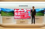 삼성전자 영상디스플레이사업부장 김현석 사장이 22일 서초동 삼성전자 다목적홀에서 2세대 퀀텀닷 기술을 채용한 SUHD TV 신제품을 소개하고 있다 (사진제공: 삼성전자)