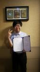 사과나무컴패션월드 첫 장애인 희망 홍보대사 고영철 청년이 위촉장을 받고 환하게 웃고 있다