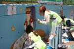 NGO단체 함께하는 사랑밭과 일성건설 임직원 봉사단 해피투게더 트루엘이 서울 영등포구 문래초등학교에서 벽화 그리기 봉사활동을 실시했다