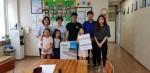 코리아텍 생활관 학생들이 축제 기간 중 소통 프로그램 수익금으로 마련한 공기청정기를 목천지역아동센터에 기증했다