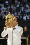 2009년 윔블던 챔피언십에서 남자 단식 우승을 차지한 롤렉스 홍보대사 로저 페더러