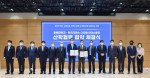 Thomas Schmid, Head of Digital Industries at Siemens Korea(Seventh from the right), and HoYoung Lee, President of Changwon National University(Seventh from the left), pose for a photo with officials from both institutions after signing an MOU to jointly foster future professionals for the 4th industrial revolution at Changwon National University in Changwon, Gyeongsangnam-do, on May 27, 2021