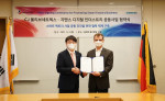 Thomas Schmid, Head of Digital Industries at Siemens Korea (Right), and InHyok Cha, CEO of CJ OliveNetworks (Left), pose for a photo after signing an MOU to jointly develop Smart Factory Business at Siemens Korea headquarters in Chungjeong-ro, Seodaemun-gu, Seoul, on September 2, 2021