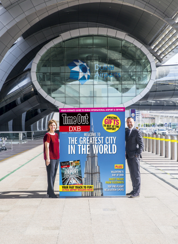 Sue Holt, Executive Director ITP Media Group and Eugene Barry, EVP Commercial at Dubai Airports with a larger than life Time Out DXB front cover