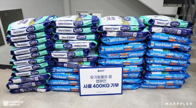 마플코퍼레이션이 마플 임팩트 굿즈 캠페인 수익금으로 동물자유연대에 사료 400kg를 기부했다