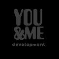 유엔미도시개발 Logo
