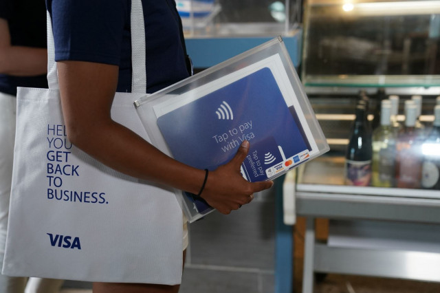 "Visa's Back to Business kits include new ""tap to pay preferred"" point-of-sale materials, branding, e..."